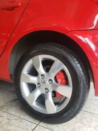 Apliques de pinças de freio da Brembo na cor vermelha