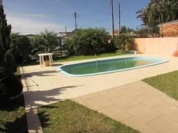 Amplo sobrado com 04 dormitórios com piscina- bairro zona nova