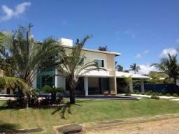 Casa com 4 suítes e Piscina com raia Semi olímpica no condomínio Busca Ville Camaçari BA