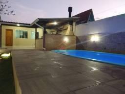 RB- Casa com dois dormitórios, piscina e vagas para 02 carros!