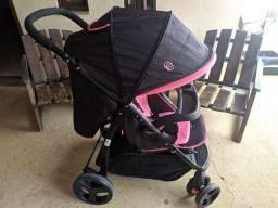 Carrinho de bebê rosa Cosco