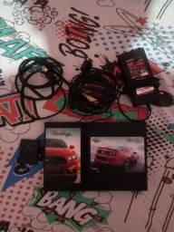 Playstation 2 , 3 controles e diversos jogos.