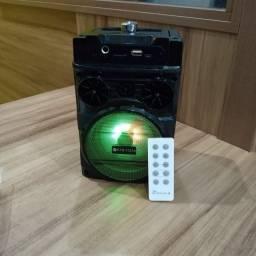 Caixa de Som via Bluetooth, controle remoto, pega rádio, pendrive e cartão de memória! Top
