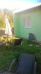 Vendo Casa em Nova Santa Rita no bairro Floresta, sozinha no pátio