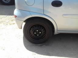 Troco rodas 14 de ferro com pneus novos.