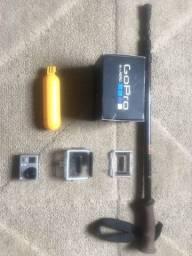 Go Pro HERO 3 + acessórios da foto + brinde bastão para trekking