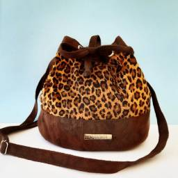 Bolsa saco animal print onça