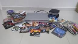 Aparelho de Dvd Gradiente com vários Dvds