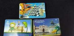 56 cartões telefônicos de várias series e sistemas