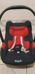 Bebê  conforto  conservado  com capa