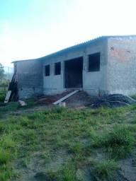 Terreno 250m com casa inacabada