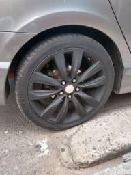 Troco aro 18 com os 4 pneus novo