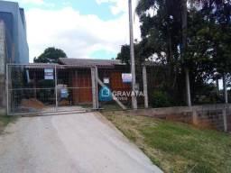 Casa com 3 dormitórios para alugar, 70 m² por R$ 1.100,00/mês - Centro - Gravataí/RS