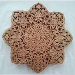 Mandala entalhada em madeira nobre