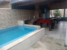 Casa na quadra do mar, com sala de jogos, piscina