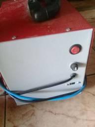 Vendo um carregador de bateria não faço entrega foi usadas poças vez