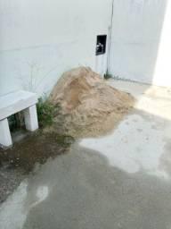 Doa se areia e banco de bloco