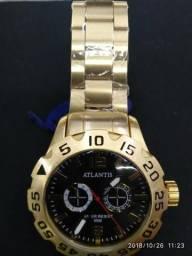c816873805c Relógio Atlantis dourado lançamento top!