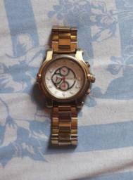 Relógio Magnum dourado