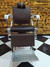 Vendo cadeira de barbeiro filé de mais 5500