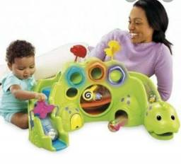 Dinossauro musical roll a rounds (Fisher price)