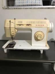 Máquina de costura singer com defeito
