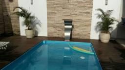 Casa com piscina na quadra do mar em Jacaraípe para temporada