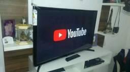 TV 32 SMART WIFI YouTube Netflix zerada na caixa c/ nota fiscal e garantia. entrego
