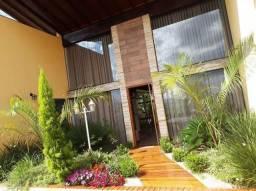 Casa com 5 dormitórios à venda, 794 m² por R$ 1.800.000,00 - Condomínio Campo Alegre - Poç