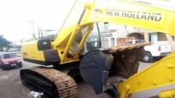 Vende se escavadeira new holland E215b ano 2012