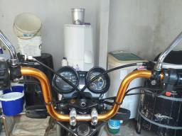 Troco guidao de moto gemoto laranjado por guidao original da 150