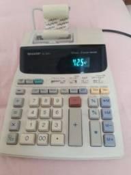 Título do anúncio: Vendo etiquetador e calculadora Sharp.