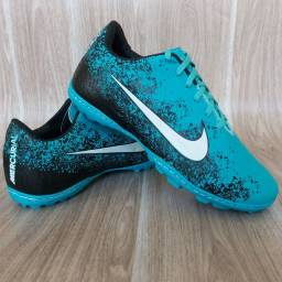 Chuteira Nike Society verde água