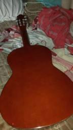 Vendo Violão Voggar Acústico e vai com um suporte de violão tbm, de chão.
