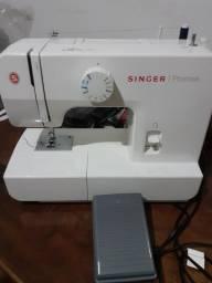 Troco por cel  máquina  de costurar  nova