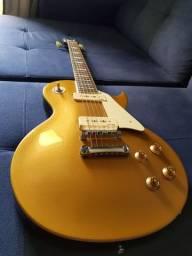 "Guitarra Les Paul Vintage V100 ""Gold Top"" Caps Wilkinson/Mogno/Braço colado - Só Venda"