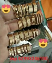 Alianças de moedas prata e ouro .,,.,,,