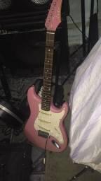 Guitarra rosa e pele luen bateria