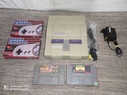 Super Nintendo com dois controles e 10 jogos! Até 12x no cartão! Com garantia!
