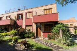 Casa em Condomínio para aluguel, 3 quartos, 1 suíte, 2 vagas, VILA NOVA - Porto Alegre/RS