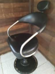 Cadeira de barbeiro.