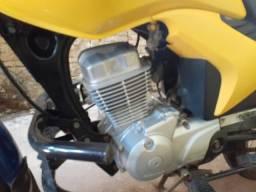 Vendo moto honda amarela