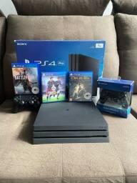 PS4 PRO de 1 TB,2 Manetes,3 Jogos,Pouco tempo de uso.