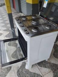 Fogão semi novo elétrico 400 reais  pegando tudo