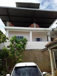 Casa com cubertura e garagem