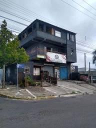 Barbada vendo um prédio em Gravataí de esquina bem localizado na RS 020