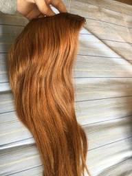 Cabelo totalmente humano mega hair na tela com tic tac ruivo