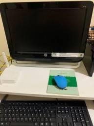 Computador HP com CPU embutido já na tela.