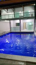 Casa com piscina e 4 quartos suítes garagem para mais de 3 carros