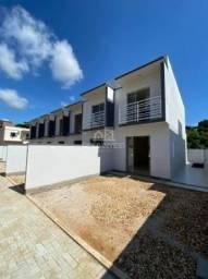 Casa em condomínio fechado em Dom Joaquim com passagem lateral